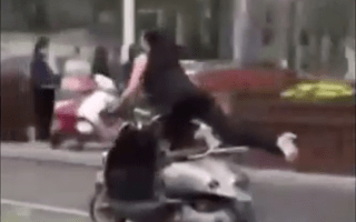 Bizarre scenes as woman does yoga on moving scooter