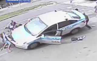 The incredible moment strangers lift a car off an injured child