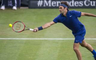 Federer's return from injury cut short by rain
