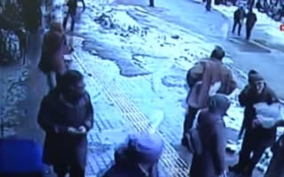 Pedestrians covered in 'snow avalanche' from shop roof (video)
