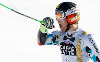 Defending champions Hirscher and Gut claim victories