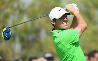 McIlroy chips in at the last to move into contention