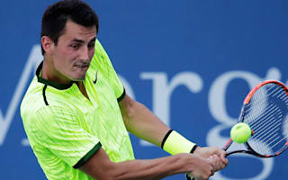 Tomic apologises after responding to heckler