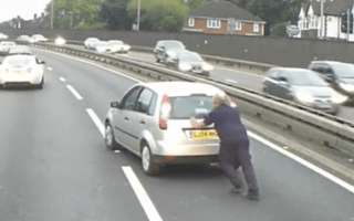 Brave lorry driver stops in busy traffic to aid stricken car