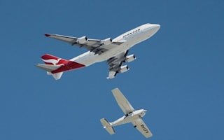Too close for comfort! Passenger plane 'shaves' light aircraft