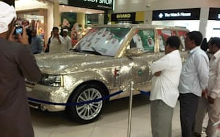 The king of bling: Coin-covered Range Rover makes a statement