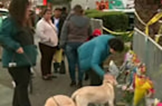 Residents lay flowers for Oakland fire dead