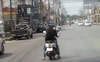Incredible video shows man sleeping while riding moped