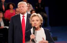 Trump takes on Clinton in tense second debate