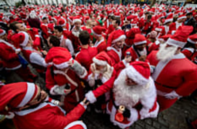 Hundreds of revellers dressed as Santa take to streets