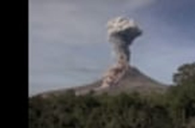 Raw: Indonesia's Sinabung Volcano Spews Hot Ash