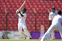 Tamim enjoys England reunion on tight second day