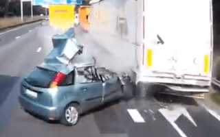 Idiot driver survives double lorry impact