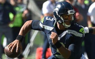 Seahawks' Russell Wilson sprains left knee in win over 49ers