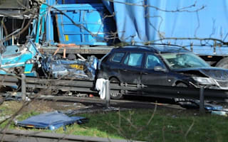 Driver in miraculous escape after car crushed between bus and lorry