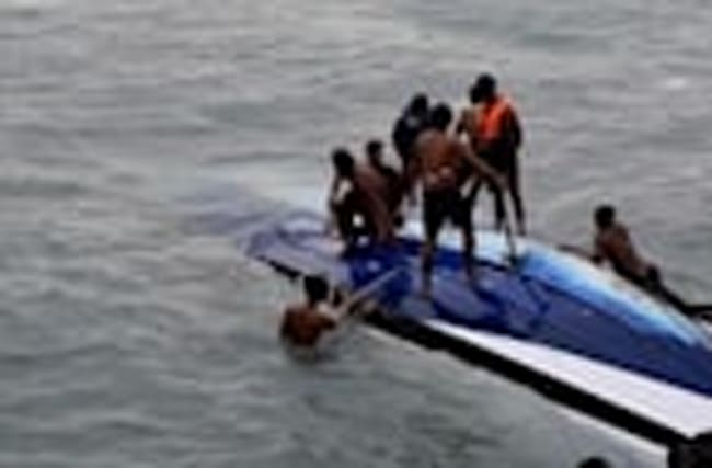 Tourist boat in Thailand capsizes, kills two