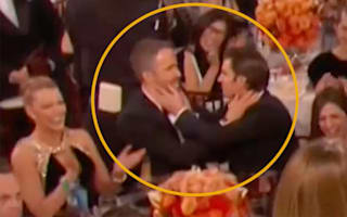 Ryan Reynolds and Andrew Garfield steal a kiss in Golden Globes prank