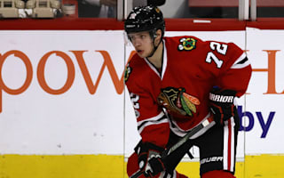 Blackhawks stay hot, Wild win shoot-out