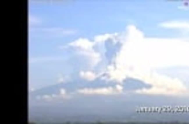 Erupting Mexico volcano fills blue sky with dark ash