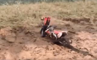 Dirt bike rider flips over handlebars in misjudged stunt