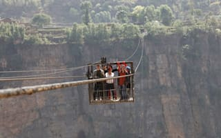 Photos: Villagers use cable car with 1,200ft drop for daily commute
