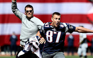 Not again! Watch as the Gronk steals Brady's jersey before Red Sox opener