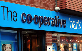 Co-op director quits after claims