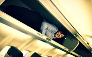 Video: Flight attendant hides in overhead locker to surprise passengers