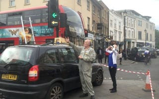 Swarm of bees creates a buzz during London's rush hour