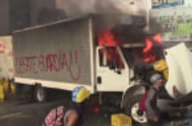 Protesters burn trucks as police use tear gas in Venezuela
