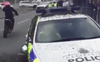 Scrambler-riding thugs smash up police car