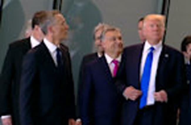 Trump shoves fellow NATO leader aside on his first summit