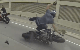 Biker learns the hard way not to stop in the middle of the road