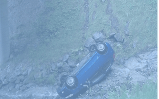 Tourist's car rolls down ravine after he stops to take photo
