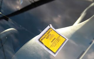 Parking wardens ticket driver who'd broken down in the middle of the road