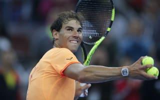 Nadal through at rain-soaked China Open