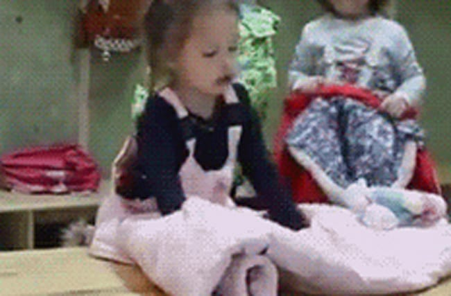 Watch little girl puts her coat on at nursery like a boss
