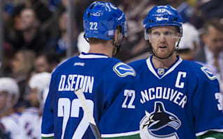 Canucks win in OT, Predators end skid