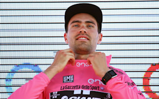 Time-trial masterclass earns Dumoulin Giro lead