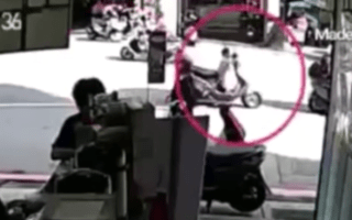 CCTV captures moment toddler rides off on dad's scooter
