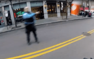 Cop suspended for throwing coffee at biker