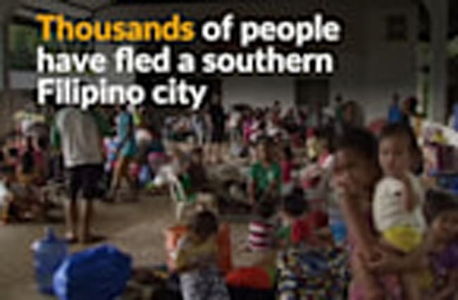 Residents flee Filipino city as fight against militants rages on