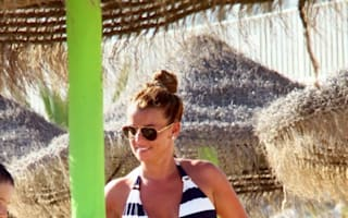 Coleen Rooney frolics in a bikini in Portugal