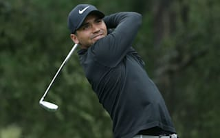 Day: Woods' back injury is double edged sword
