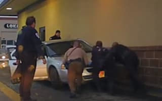 Utah driver gets trapped between vehicle and McDonald's wall