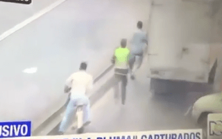 Quick-thinking truck driver brings down thief by opening his door