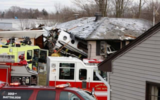 Two dead and boy lucky to be alive after plane crashes into house