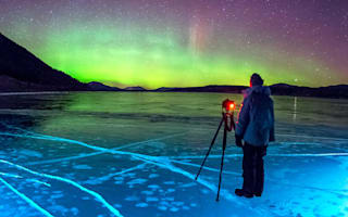 Frozen ice bubbles lit up by Northern Lights in Canada