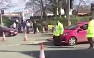 Marshal shunted across street during Manchester marathon