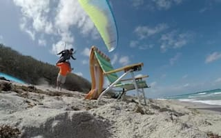 Hang glider attempts to land in chair